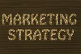 Marketing strategy writing with glowing gearwheels pattern — Foto de Stock