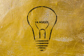 Lightbulb with filament saying Innovate — Stock Photo
