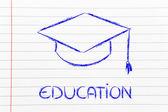 Graduation hat and Education writing — Stockfoto