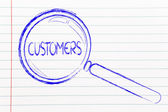 Finding customers, magnifying glass focusing on clients — Stock Photo
