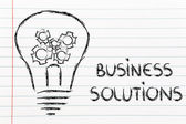 Business solutions, lightbulb with gearwheels — Stock Photo