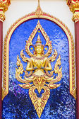 Thai Golden guardian god with sword decorated at the temple wall. — Photo
