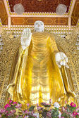 Ancient Golden Buddha image in a Burma Buddhist temple. — Stock Photo