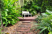 Garden Walkway foot path and bench chair. — Stock Photo