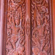 Ornament wooden door of Thai temple in Chiangmai, Thailand — Stockfoto