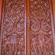 Ornament wooden door of Thai temple in Chiangmai, Thailand — Стоковая фотография