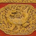 Постер, плакат: Naga Fusion Swan Wall sculpture on Ubosot in Wat Saen Fang