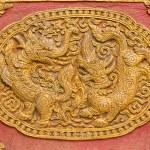 Постер, плакат: Singha Wall sculpture on Ubosot in Wat Saen Fang Chiangmai