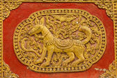 Dog Wall sculpture on Ubosot in Wat Saen Fang , Chiangmai — Stock Photo