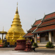 Stock Photo: Golden Chedi which is major place of worship, PhrThat Hariph