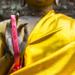 Garland wear on golden buddha hand — Stock Photo