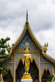 Buddha statues and Ubosot in Thai temple — Stock Photo