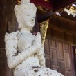 Stock Photo: Sculpture of White angel With Teak temple, LannStyle in Thailand