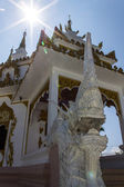 Naga statue with White pagoda in thai temple — Stock Photo