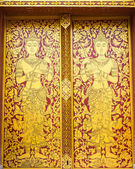 Thai ancient art Gold angel painting on door in temple — Stock Photo