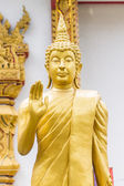 Standing Thai Golden Buddha statue — Stock Photo