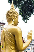 Back Standing Thai Golden Buddha statue — Stock Photo
