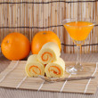 Stock Photo: Roll cake and orange juice