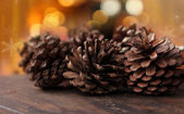 Pine cones on christmas background — Stock Photo