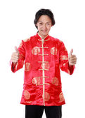 Asian man is smile and hand with thumb up in chinese new year da — Stock Photo
