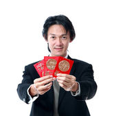 Businessman show cash gift pocket money for chinese new year — Stock Photo