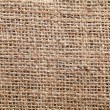 Piece of frayed burlap on background — Stock Photo #44467215