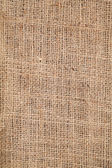 Piece of frayed burlap background  — Stockfoto