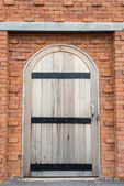 Wooden door on the brick wall — Photo