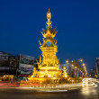 CHIANG RAI - JAN 2 : Light trails on street around golden clock tower, established in 2008 by Thai visual artist Chalermchai Kositpipatat, at night on January 2, 2014 in Chiang Rai, Thailand. — Stock Photo