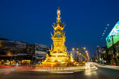 CHIANG RAI - JAN 2 : Light trails on street around golden clock tower, established in 2008 by Thai visual artist Chalermchai Kositpipatat, at night on January 2, 2014 in Chiang Rai, Thailand. — Foto Stock