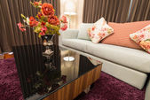 Sofa with decorative flower — Stock Photo