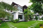 Modern house in the garden  — Stock Photo