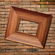 Picture frame on brick wall background — Stok Fotoğraf #35496841