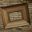 Picture frame on brick wall background — Stok Fotoğraf #35497231