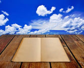 Beauty seascape under blue clouds sky.Book on wood planks — Stock Photo