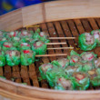 Stock Photo: Chinese snack dimsum with bamboo stick on wood