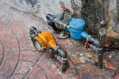 Vintage yellow and blue water meters — Stock Photo