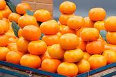 Orange fruits green leaves in market — Stock Photo