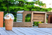 Coffee on the wood garden table — Foto Stock