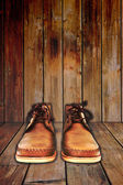 Brown shoes on wood background. — Stock Photo