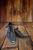 Black shoes on wood background. — Stock Photo