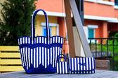Luxury women bag on table in garden — Stock Photo