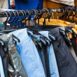 Stock Photo: Colors of rainbow. Variety of casual trousers on hangers