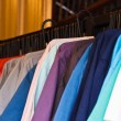 Stock Photo: Colors of rainbow. Variety of casual shirts on hangers