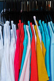 Colors of rainbow. Variety of casual shirts on hangers — Stok fotoğraf