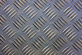 Metal with repetitive patten backgound — Stock Photo