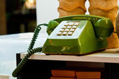Vintage telephone on old table — Stockfoto