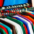 Colors of rainbow. Variety of casual shirts on hangers — Stock Photo #41976063