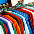 Colors of rainbow. Variety of casual shirts on hangers — Stock Photo #41976209