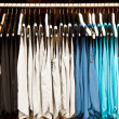 Colors of rainbow. Variety of casual shirts on hangers — Stock Photo #41977553